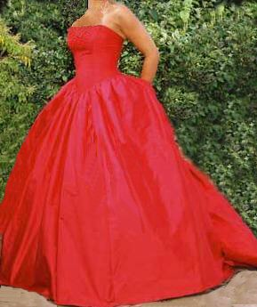 Wedding dress by Judith Craig Couture. strapless fitted bodice with full skirt in red silk dupion.