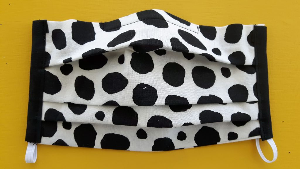 white with black spots face mask