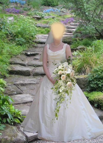 Sleeveless wedding gown with ruched bodice and full skirt in ivory dupion silk