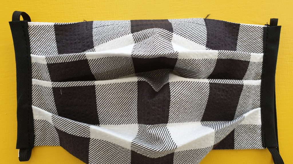 Black grey and white checked face covering